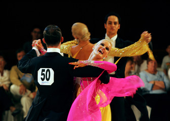 Australian couple Matthew Rooke and Anna Longmore compete during the 6th SGDF Singapore Open ...