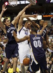 Dallas Mavericks forward Nowitzki is stripped of the ball by Memphis Grizzlies forward Arthur on the play in the NBA basketball game in Dallas