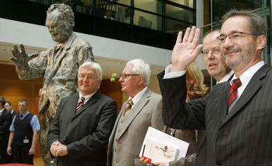 Vogel, former chairman of the German Social Democratic Party poses with his fellow party members German Foreign Minister Steinmeier, German Finance Minister Steinbrueck and Brandenburg's State Prime Minister Platzeck at the party headquarters in Berlin