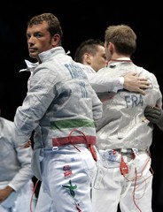 Italy's Tarantino reacts to his team's defeat in men's fencing team sabre final against France in Athens.