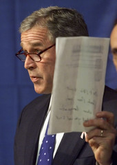 BUSH HOLDS UP PAGE FROM MCCAIN WEBSITE LISTING PROPOSED SPENDING CUTS.
