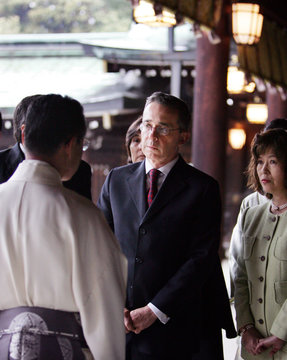 Colombia's President Uribe listens to a Shinto priest explaining the background of Meiji Shrine in Tokyo.