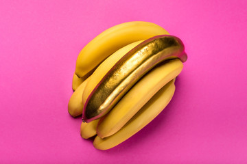 Top view of yellow and golden bananas isolated on pink, ripe bananas