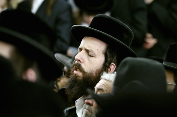 Ultra-Orthodox Jews attend the funeral of sage Rabbi Yisroel Grossman at a synagogue in Jerusalem