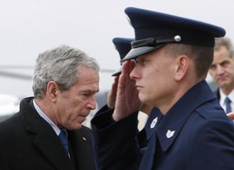 U.S. President George W. Bush boards Air Force One at Andrews Air Force Base near Washington