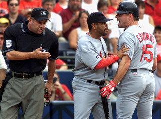 CARDINALS EDMONDS SEPARATED BY COACH FROM HOMEPLATE UMPIRE AFTER DURINGARGUEMENT IN ATLANTA.