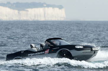 RICHARD BRANSON SETS NEW WORLD RECORD IN CROSSING ENGLISH CHANNEL IN AN AMPHIBIOUS VEHICLE.