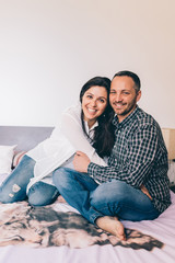 Man and woman couple lying couch indoor