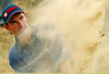 REPUBLIC OF IRELAND'S HARRINGTON CHIPS OUT OF A BUNKER ON THE 6THDURING PRACTICE FOR BRITISH OPEN AT ...