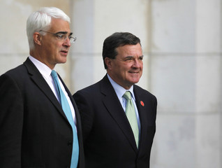 British Chancellor of the Exchequer Alistair Darling speaks with Canada's Finance Minister Jim Flaherty before a group photo at the G20 Finance Ministers summit