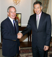 New York Mayor Bloomberg is greeted by Singapore's Prime Minister Lee Hsien Loong in Singapore.