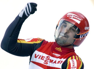 Germany's Hackl celebrates after winning a men's luge World Cup event in Innsbruck.