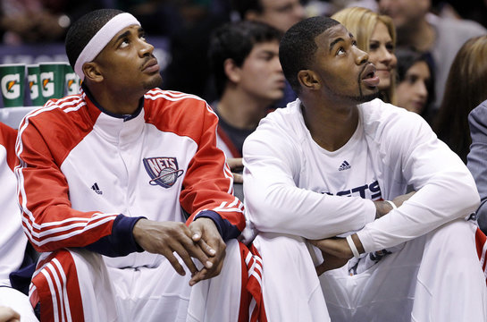 New Jersey Nets Terrence Williams and Sean Williams look at the scoreboard during the first quarter of their NBA basketball game against the Dallas Mavericks in East Rutherford, New Jersey,
