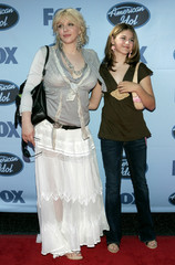 Rock star Courtney Love and her daughter Frances Bean arrive at the American Idol grand finale in Hollywood.