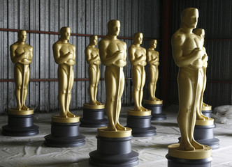 Large Oscar statues are seen before getting a fresh coat of paint by scenic artists near Los Angeles