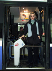 JOURNALIST FACES TURNSTILE INSTALLED AT FRONT DOORS OF ISRAELI BUS IN RAMAT HASHARON.