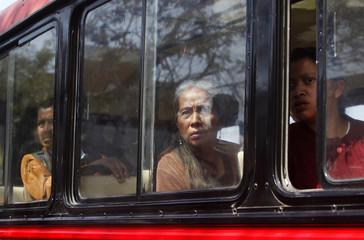 People look through bus windows at crime scene in Guatemala City