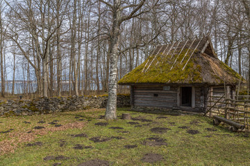 Old wooden house in the countryside in Estonia in springtime