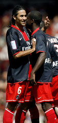 Paris Saint-Germain's Diane celebrates after scoring against Valencia during their Emirates Cup tournament soccer match in London