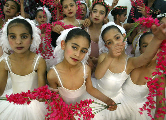 Iraqi ballerinas pose following performance on opening day of Childrens Festival in Baghdad