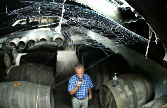 -PHOTO TAKEN 13OCT04- Wine maker Artur Olim smells a sample of vintage Madeira wine in the storage a..
