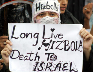 Shi'ite Muslim protester holds placard during anti-Israel rally in Islamabad