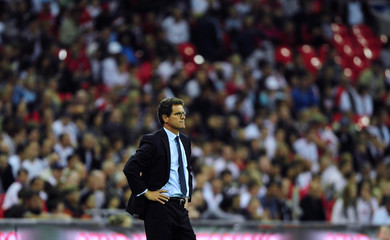 England's Capello watches his team against Slovenia during their international friendly soccer match in London