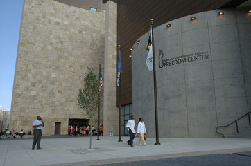 Visitors walk past the National Underground Railroad Freedom Center before the dedication ceremony in ...