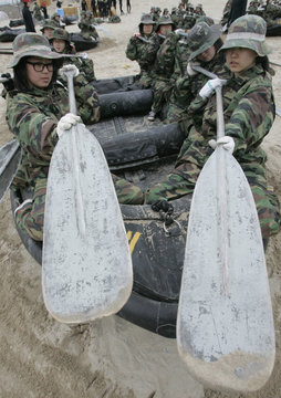 Students learn how to row a rubber dinghy at a military training camp for civilians organised by South Korean marines in Pohang