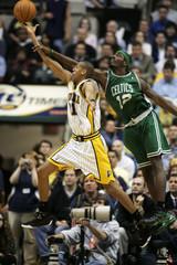 Ricky Davis fouls Reggie Miller during the NBA playoffs.