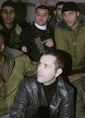 French citizen sits between Palestinian militants before his release in Nablus