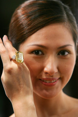 An 83.48-carat yellow diamond by Harry Winston is shown by a model during auction preview in Hong Kong