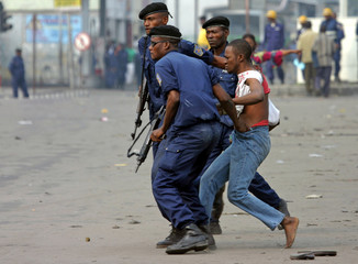 Congolese police arrest a protester during a march in Kinshasa.