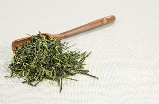 Tea leaf (Sencha) isolated on white background.