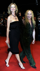 "Model Herzigova and fashion designer Galliano pose during red carpet arrivals for ""Sin City"" at the ..."