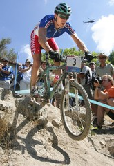France's Julien Absalon competes in the women's mountain bike event in Athens.