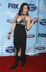 "Contestant Gina Glocksen poses at the ""American Idol"" Top 12 contestant party in Los Angeles"