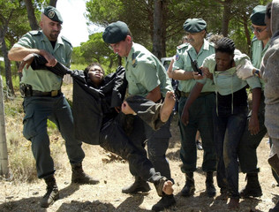 SPANISH CIVIL GUARDS HELP CARRY ILLEGAL IMMIGRANTS WITH HYPOTHERMIAFOUND NEAR TARIFA.