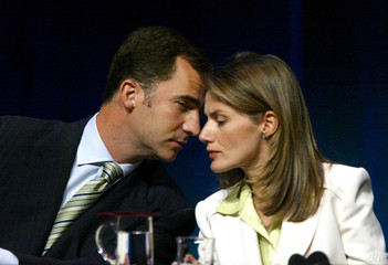 Spanish Prince Felipe talks to his wife Princess Letizia during the closing ceremony of the Forum ...