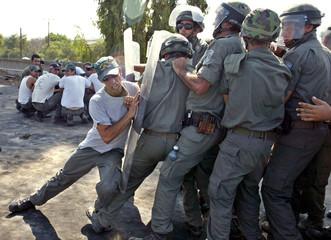 Israeli border police in riot gear train in Julis army base in southern Israel's Negev desert.
