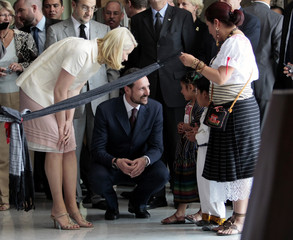 Norway's crown prince Haakon and crown princess Mette-Marit smile at indigenous Mexican children in Mexico City