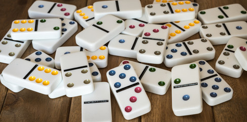 Dominoes on wooden table