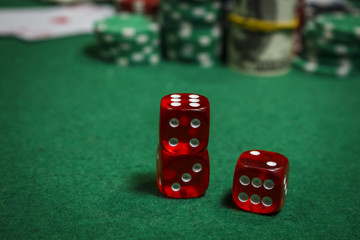 Red dice on a green table