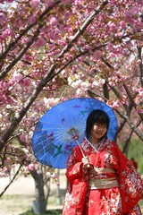 A Chinese girl wears traditional Japanese clothes to get her picture taken by a professional ...