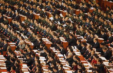 Delegates listen as China's President Hu Jintao speaks in Beijing