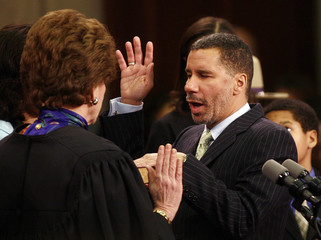 Hon. Kaye, chief judge of New York, swears in David Paterson as the 55th Governor of the State of New York during a ceremony at the state capitol building in Albany, New York