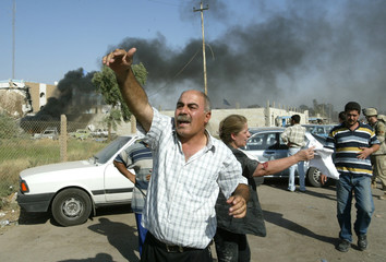 PEOPLE SHOUT FOR HELP OUTSIDE OF THE UNITED NATION HEADQUARTERS INBAGHDAD.