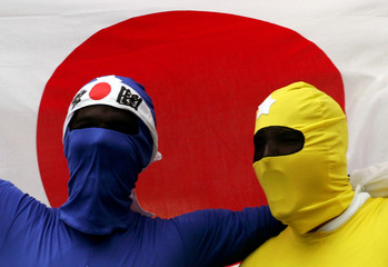 Fans dressed as Japanese cartoon figures Power Rangers shout during Rugby World Cup Sevens in Hong Kong.