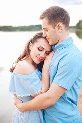 Close up romantic beauty portrait of happy couple in love hugs and having fun, evening sunlight,