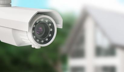 Telecamera da videosorveglianza con casa sullo sfondo, allarme